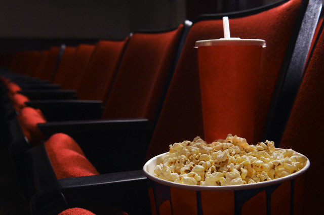 Popcorn and drink in an empty theater